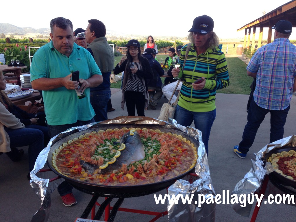 A few of the Camelbak employees from Latin America take pictures of one amazing looking Salmon Paella.
